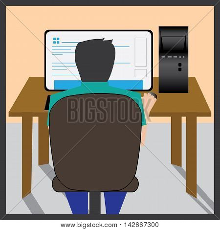 A back view of a boy engrossed in studying or working at the study table.