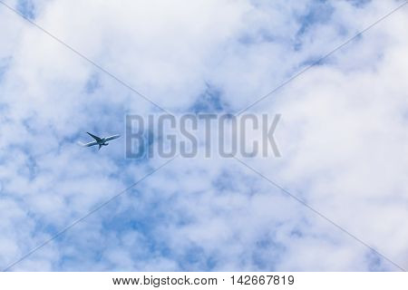Airplane climb up through clouds into the sky after departure (copy space)