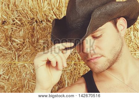 Young man wearing cowboy hat