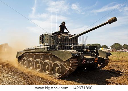 WESTERNHANGER, UK - JULY 18: A vintage WW2 ex British army Cromwell tank gives a display to the watching public at the War & Peace show on July 18, 2014 in Westernhanger
