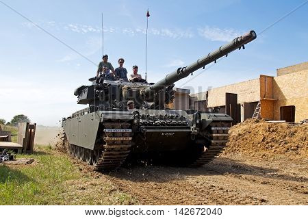 WESTERNHANGER, UK - JULY 16: A vintage Centurion tank from the Korean war period displays its power to the watching public in the main arena at the W&P on July 16, 2014 in Westernhanger