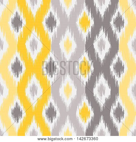Seamless geometric pattern, based on ikat fabric style. Vector illustration. Yellow and gray ogee pattern. Carpet rug  texture vector imitation.