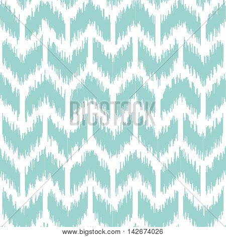 Seamless geometric pattern, based on ikat fabric style. Vector illustration. Chevron pattern in mint color. Teal and white chevron pattern.