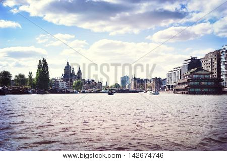 Cityscape of Amsterdam, the Netherlands. View from Amstel river