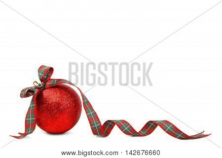 Red Christmas ball and ribbon isolated on white background.