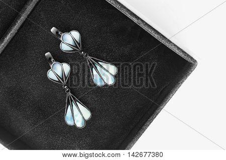 Elegant nacre earrings in black jewel box