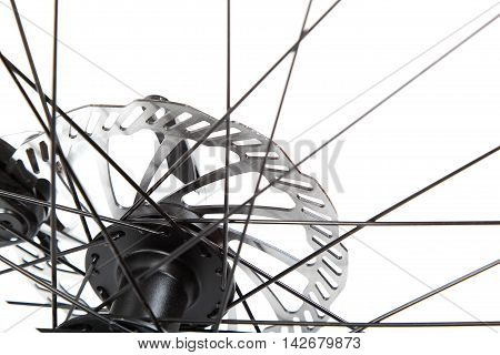 Bicycle wheel with spokes isolated on a white background.