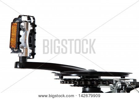 Bicycle pedal with sprocket isolated on a white background.
