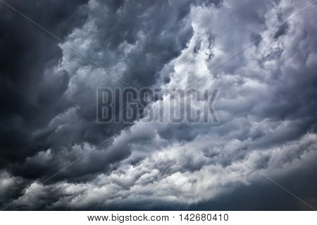 Dark sky with a gloomy storm clouds.
