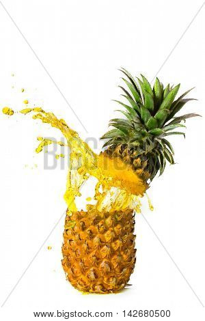 Pineapple juice splashed from pineapple on white