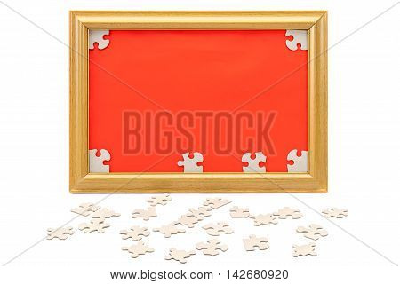 Image in the frame and scattered puzzle isolated on white background.