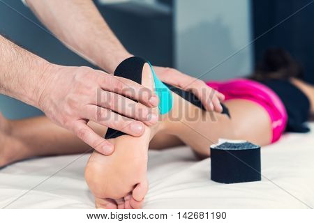 Kinesio Taping Physical Therapy, toned image, close up