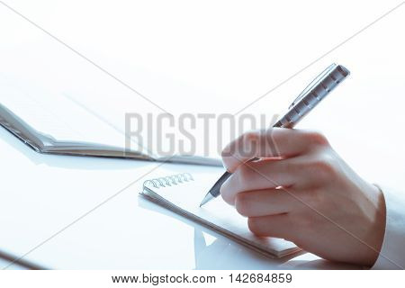 female business hand with pen. studio shot