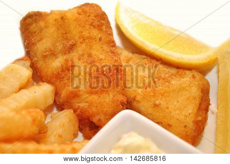 Close-Up of Fish and Chips with Lemon Wedges