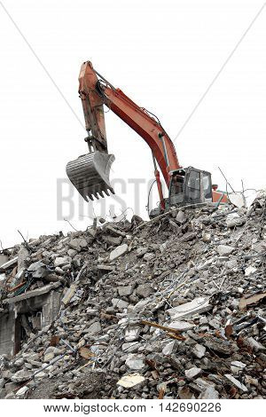 a excavator working on house demolition debris.