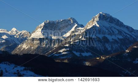 Snow covered mountains on a winter morning. View from Schwyz. Mt Schwalmis and Mt Brisen.