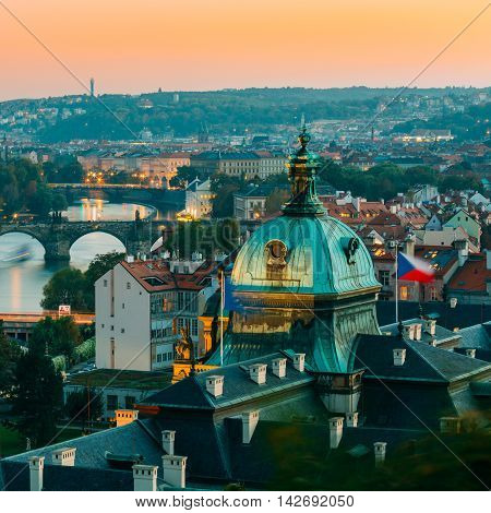 Evening View Of Cityscape Of Prague, Czech Republic. In The Right Part Of Photo We Can See The Blue Dome Of The Straka Academy. The Straka Academy Is The Seat Of The Government Of The Czech Republic