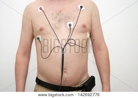 A man wearing a holter monitor device