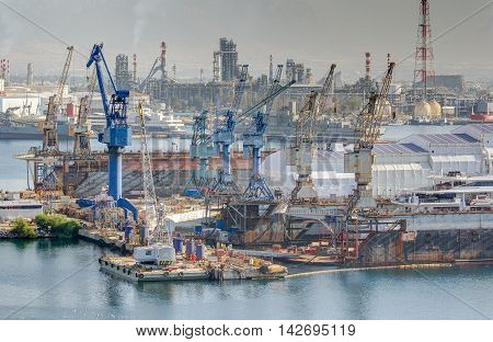 Heavy industrial zone with shipyard and refinery