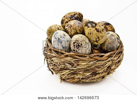 Wooden basket with eggs isolated on white background
