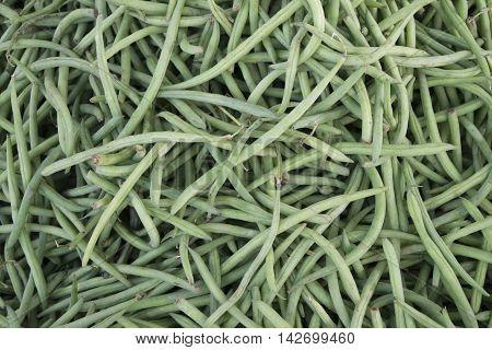 Green beans in bulk on a rural market.