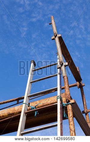 Looking up at a scaffolding tower and ladder