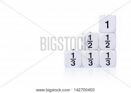 White fraction dices whole half third on white background with light reflection and copy space for text