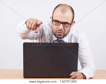 Angry  Businessman Sitting At His Desk