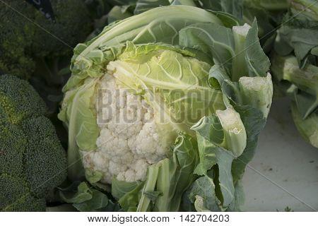 Cauliflower in bulk on a rural market.