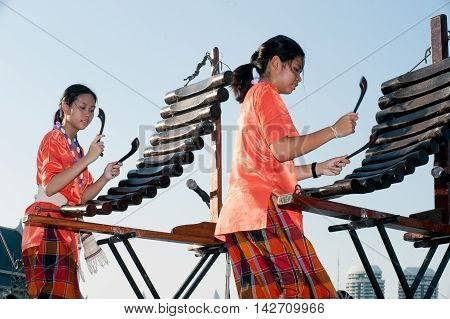 BANGKOK,THAILAND-APRIL 20,2015:Unidentified people of Thai music band playing Pong Lang traditional instrument during festival on The 233 rd Year of Rattanakosin City on April 20,2015,The show is open free for public.