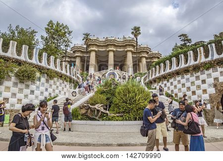 BARCELONA SPAIN - JULY 3 2016: Park Guell in Barcelona. Park Guell (1914) is the famous architectural town art designed by Antoni Gaudi