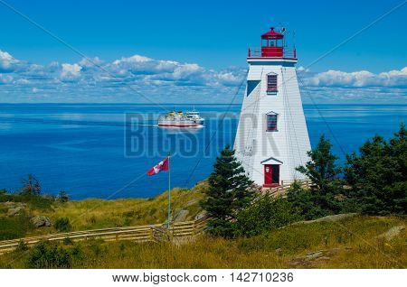 The Swallowtail lighthouse with the ferry sailing by