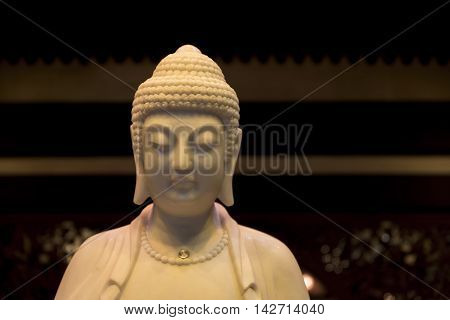 Head and shoulders of the Buddah, in mock ivory material