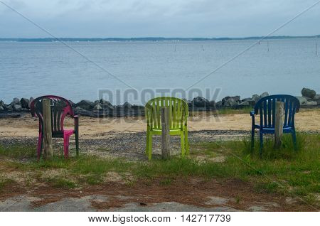 Three chairs stand ready for use in a campground in Delaware