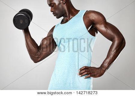 Fitness Male Model Working Out With Dumbbells