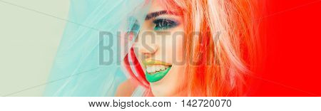 Young girl with pretty face bright professional makeup colorful eyeshadow yellow and green lips and orange hair wig wearing blue veil