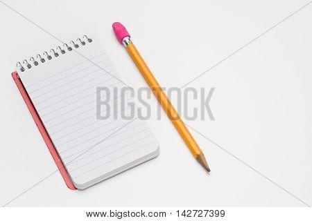 Pocket size spiral notebook on a white background