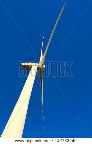 Renewable Wind Energy : Wind Turbine over blue sky