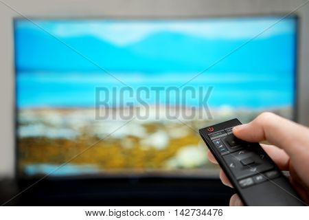 Television remote control changes channels, close-up .