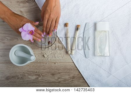 Woman having a spa manicure in beauty salon