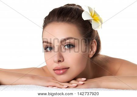 Portrait of young beautiful woman laying in spa salon isolated over white background. SPA therapy skincare recreation and cosmetology concept