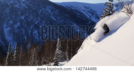 Freeride run in moutains of Siberia, powder run