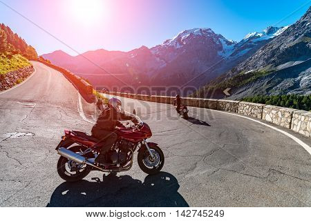 Sunset Above Motorbike On Passo Stelvio
