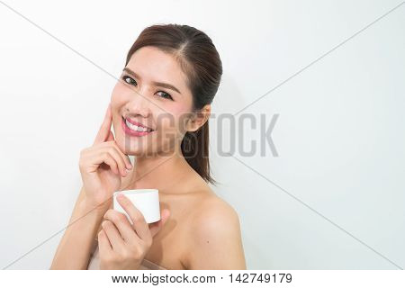 Woman, Close Up Studio On White Background. Beauty Female Face With Perfect Make Up. Holding Cream F