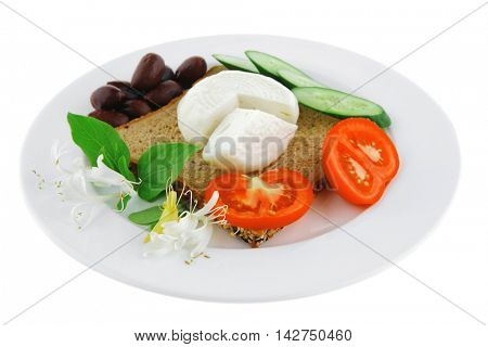 low fat mozzarella on white with tomatoes and olives