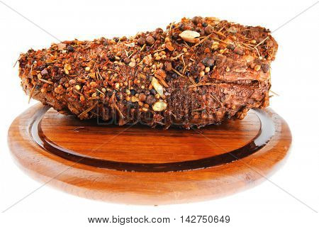 grilled meat in spices over white background