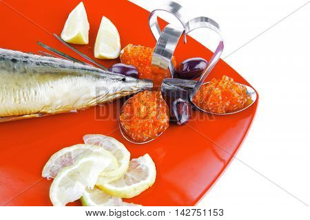 fish on red plate with lemon and caviar