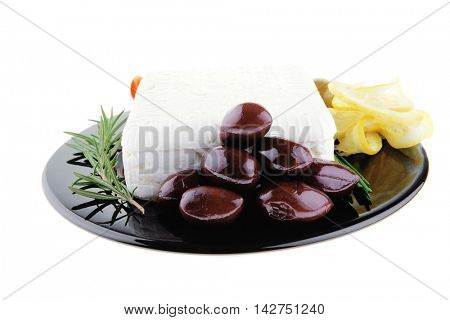 image of feta cheese and olives on black