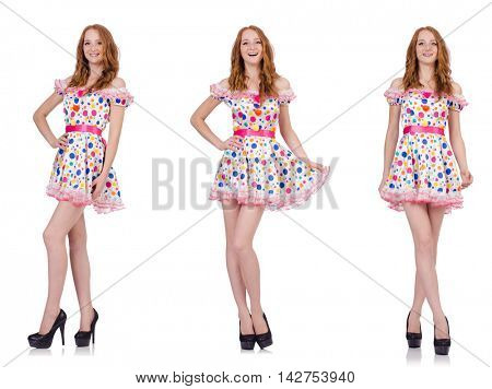 Young woman in polka dot dress isolated on white