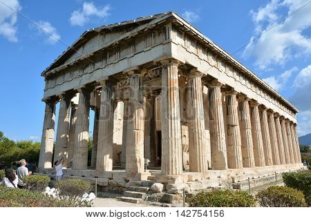 ATHENS, GREECE - OCTOBER 19: Tourists visit the ancient Temple of Hephaestus OCTOBER 19,  2014 in Athens, Greece